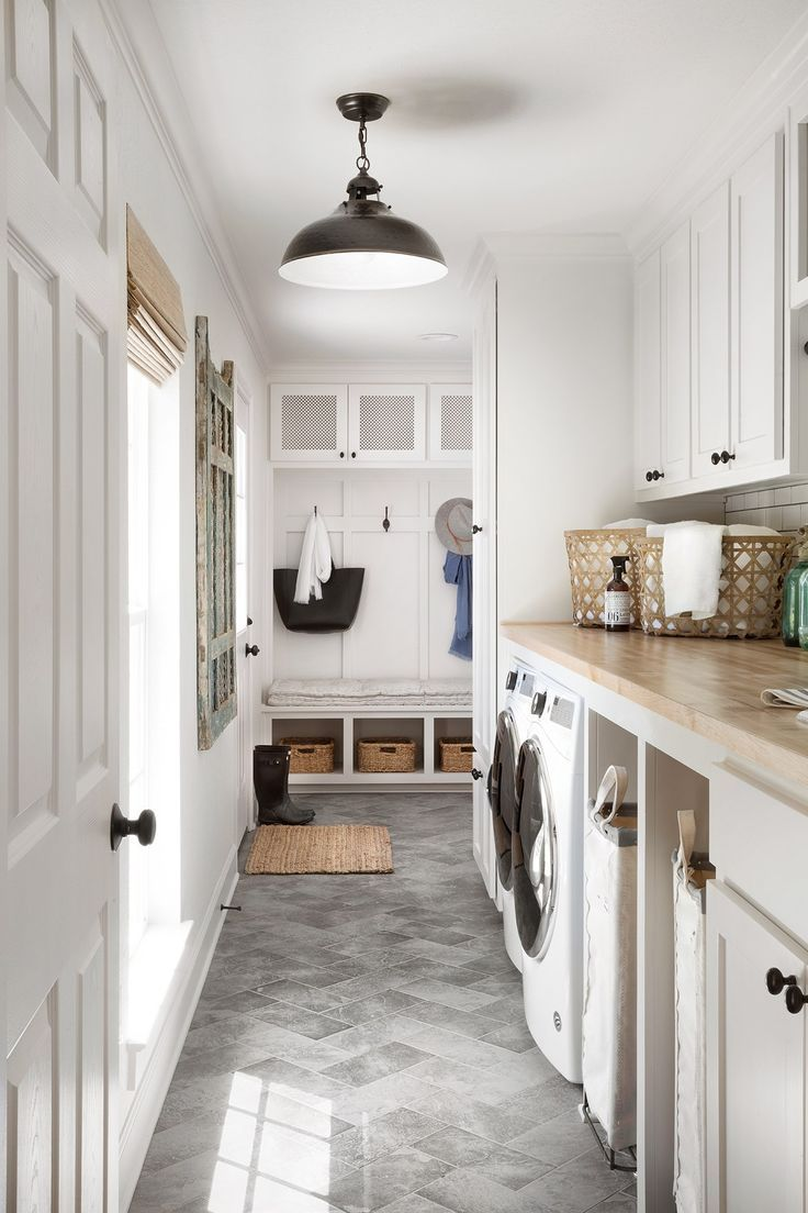laundry room, grey floor tiles, white wall, white cabinet, wooden top, black pendant, white cabinet, big glass window