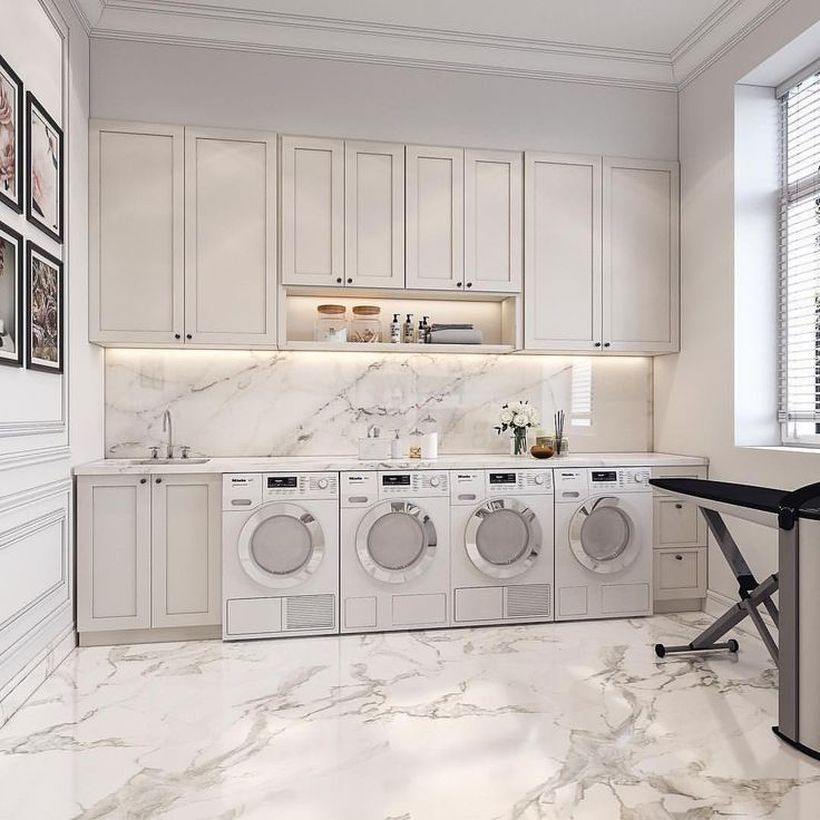 laundry room, white marble floor, white wall, white cabinet, white washing machines