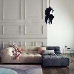 Living Room, Black Floor, White Wall, White Wainscoting, White Lounge Sofa, Blue Lounge Sofa, Black Pendant