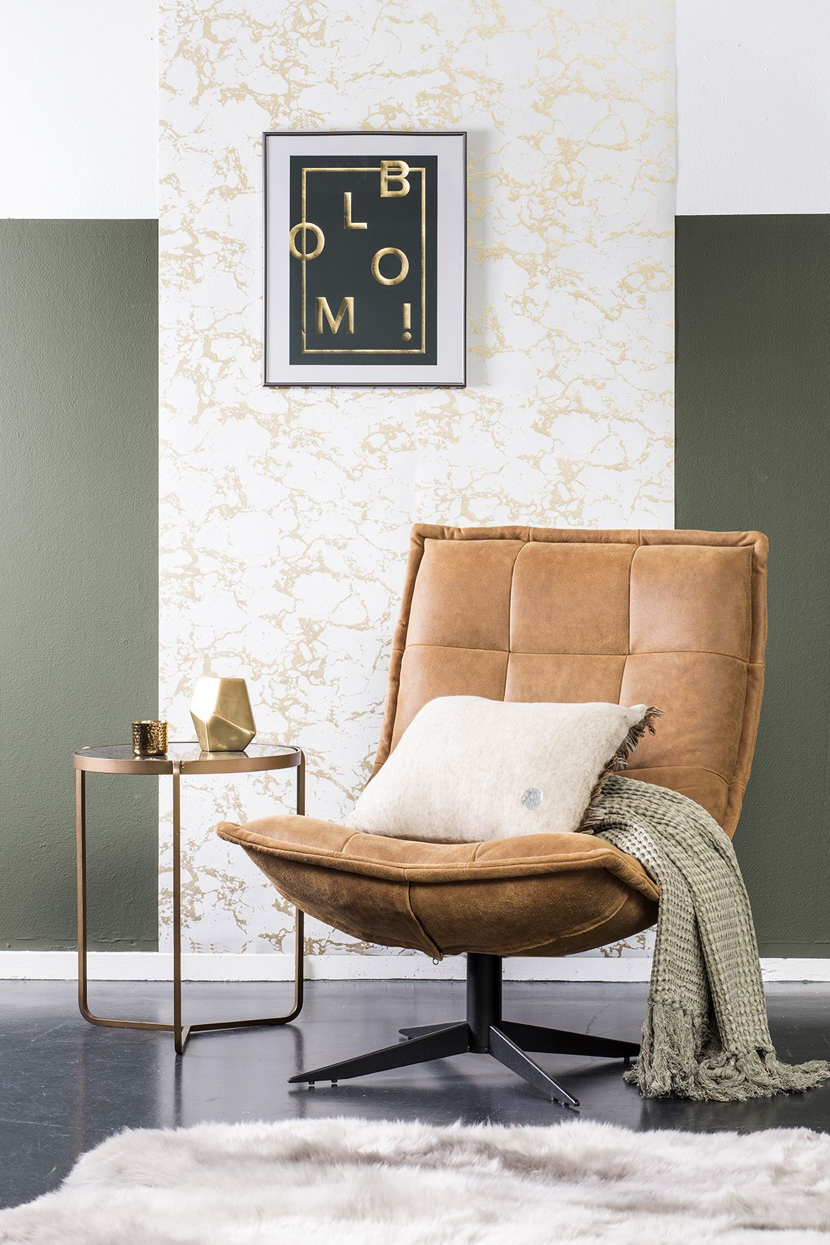 living room chair, brown leather lounge chair, black seamless floor, green wall, marble accent wall, glass golden side table