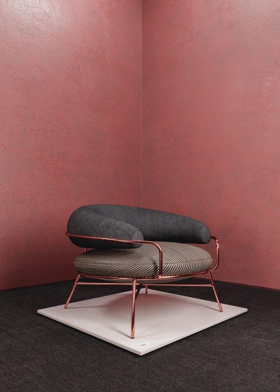 living room chair, dark grey floor, pink wall, chopper framed chair, dark grey cushion