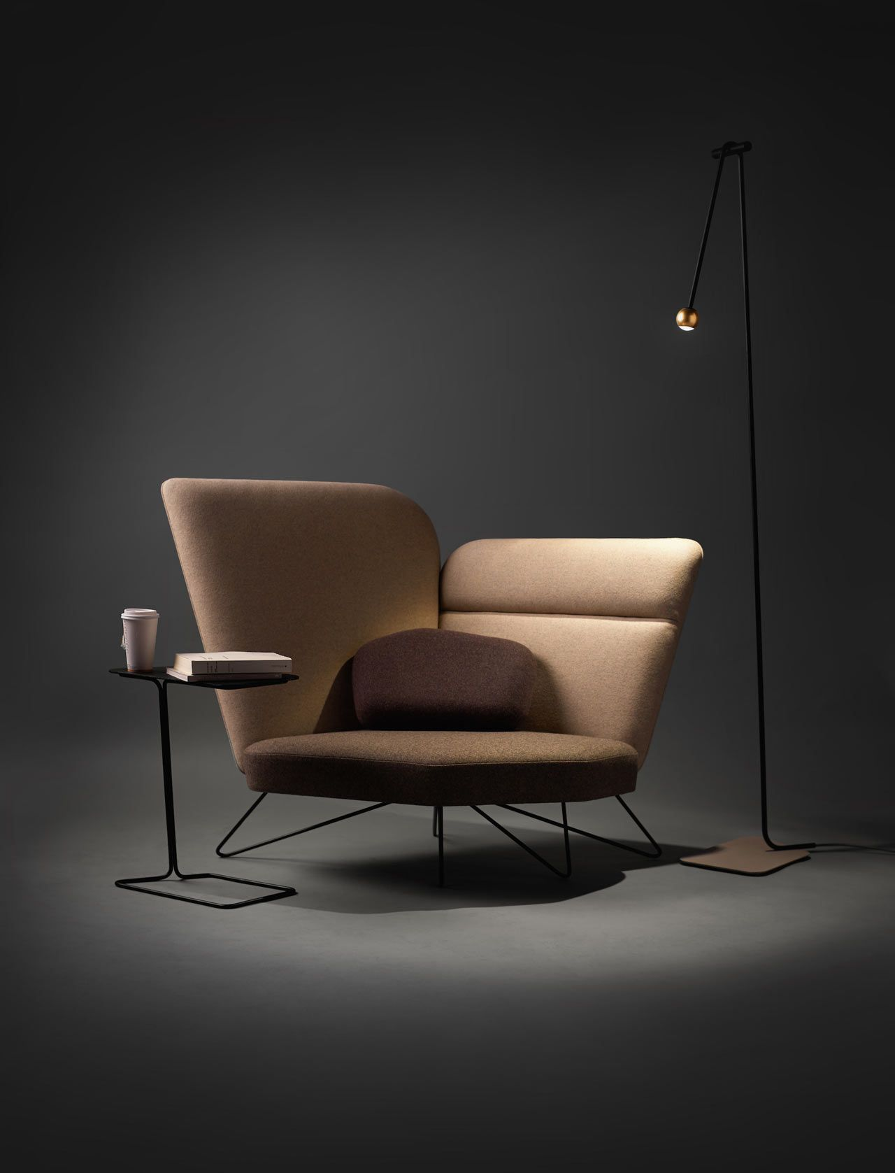 living room chair, grey wall and floor, brown chair, black ironed side table, black iron floor lamp