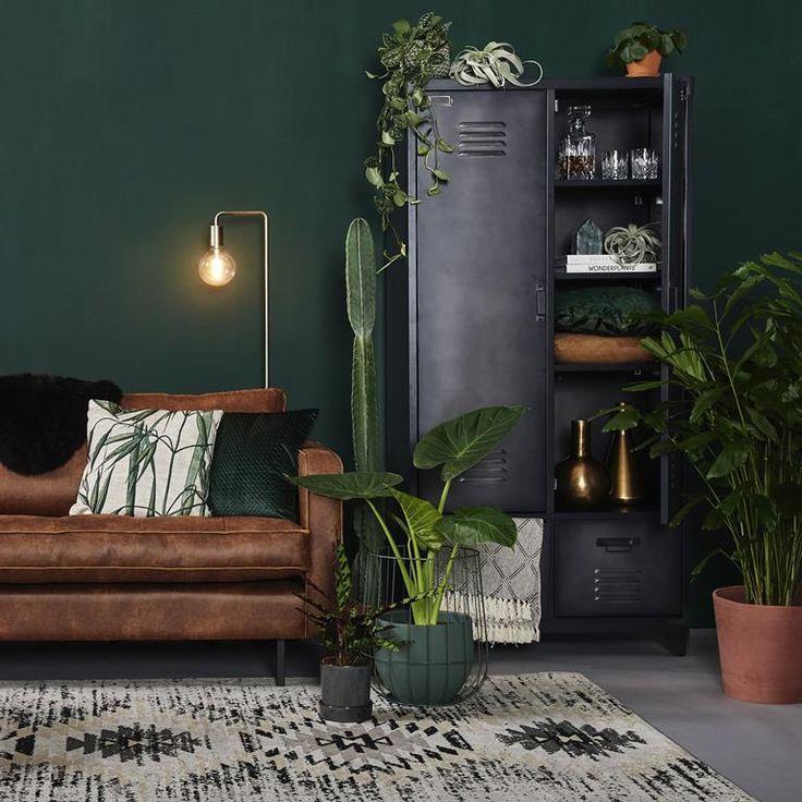living room, grey floor, brown leather sofa, black cabinet, patterned rug