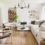 Living Room, Rattan Rug, White Wall, Indented Nook, Floating Shelves, White Sofa, Wooden Chair With Grey Cushion