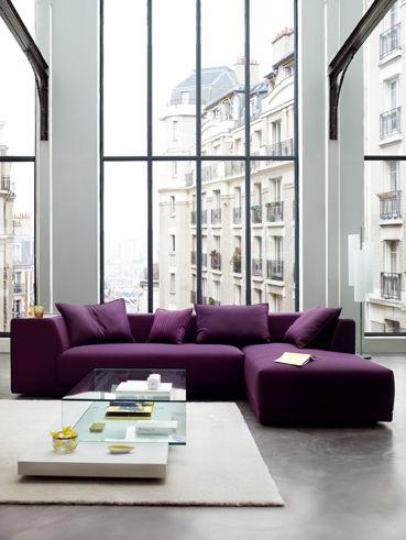 living room, seamless grey floor, glass wall, purple sofa, coffee table