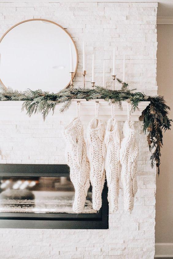 living room, white exposed brick, garland, white woven sock, round mirror,