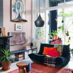 Living Room, White Floor, Red Rug, Cream Wall, Black Shelves, Black Pendants, Black Fireplace, Dark Green Sofa