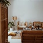 Living Room, White Floor, White Wall, Rattan Chairs, Glass Coffee Table, Wooden Sofa With Brown Cushion