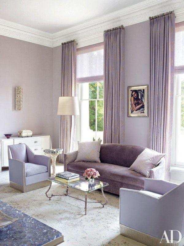 living room, white marble floor, light purple wall, light purple velvet sofa, light blue chairs, glass coffee table, white cabinet, purple curtain