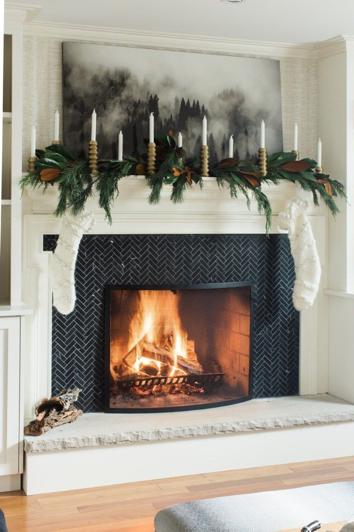 living room, white wall, black fireplace, garland, candles