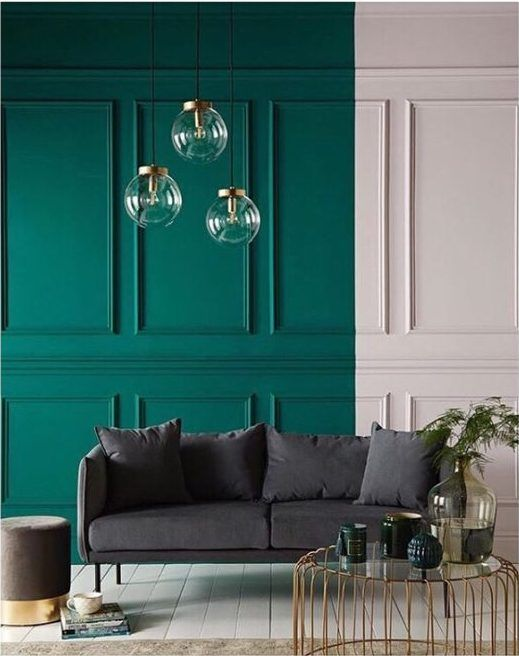 living room, white wooden floor, green white block wall, glass pendants, dark sofa, glass coffee table