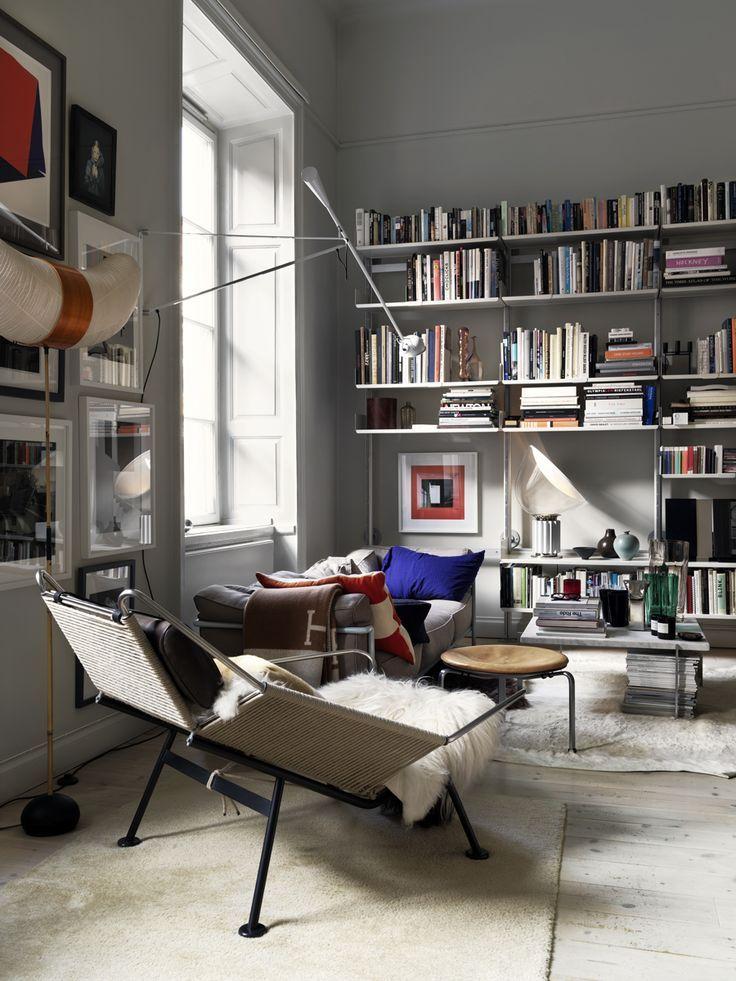 living room, white wooden floor, white wall, white sofa, white marble coffee table, white lounge chair, white thin book shelves