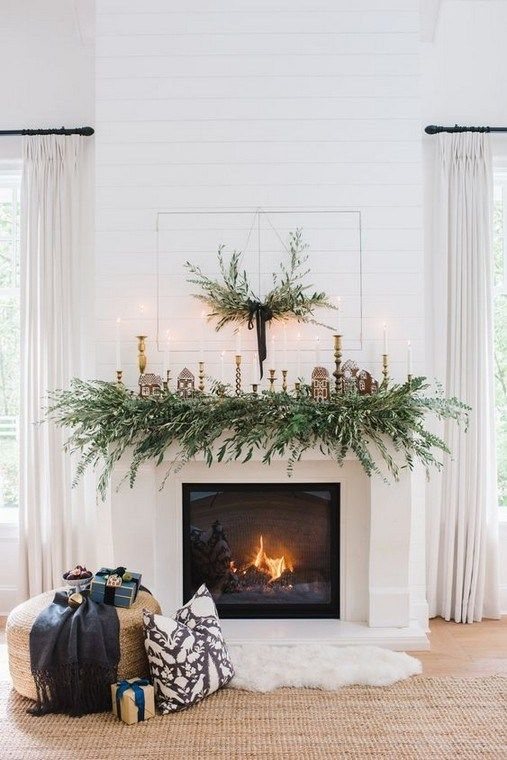 living room, white wooden wall, wooden floor, white fireplace, garland, round ottoman