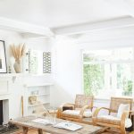 Living Room, Wooden Floor, Brown Rug, White Wall, Rattan Chairs, Wooden Coffee Table, White Built In Shelves, White Sofa, White Beamed Ceiling