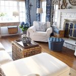 Living Room, Wooden Floor, Light Wall, White Sofa, White Chair, White Brick Fireplace, Blue Tufted Ottoman, Wooden Console Table