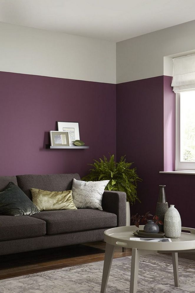 living room, wooden floor, purple wall, white tray coffee table, grey sofa, white wall