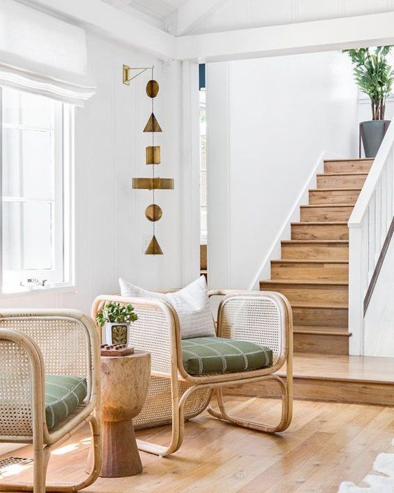 living room, wooden floor, rattan chair, green cushion, wooden side table, white wall