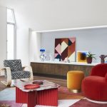 Living Room, Wooden Floor, Red Velvet Chair, Yellow Ottoman, Zebra Patterned Chair, Red Geomterical Rug, Red Coffee Table