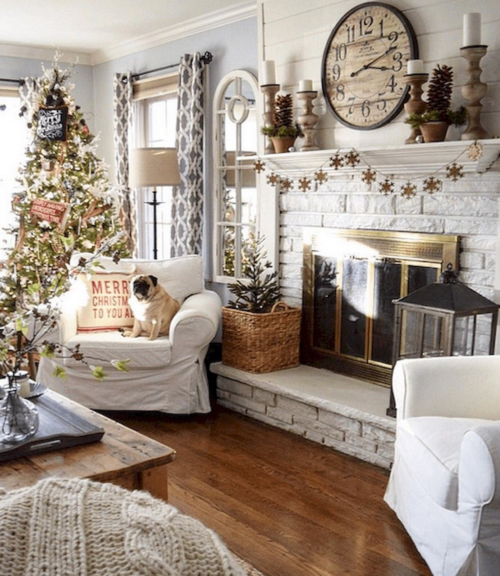 living room, wooden floor, white brick foreplace, white chairs, wooden coffee table, white shiplank