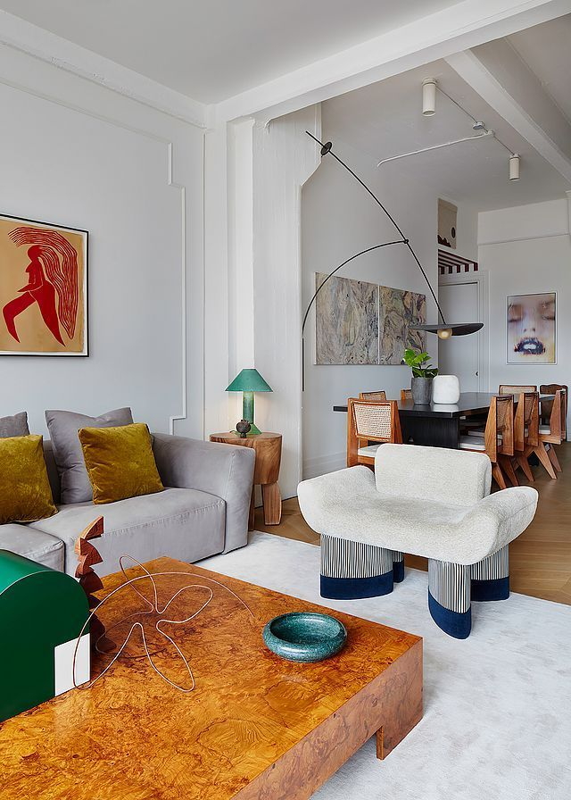living room, wooden floor, white rug, white chair, grey sofa, wooden coffee tbale