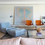 Living Room, Wooden Floor, White Wall, Blue Bean Bag, Blue Ottoman, Glass Table, Brown Chairs, Grey Floor Lamp