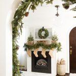 Living Room, Wooden Floor, White Wall, Clear Bulb Pendant, White Black Fireplace, White Patterned Rug, Garland And Mistletoe
