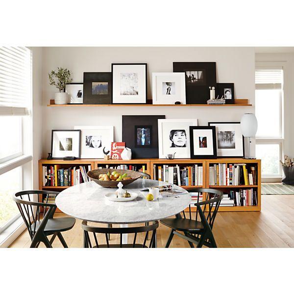 living room, wooden floor, white wall, wooden floating shelves, wooden shelves box on the floor