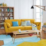Living Room, Wooden Floor, White Wall, Yellow Sofa, Wooden Shelves, Sconce, Wooden Coffee Table