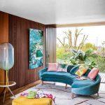 Living Room, Wooden Floor, Wooden Wall, Blue Velvet Sofa, Yellow Velvet Ottoman, Grey Rug, Large Glass Window