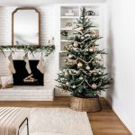 Living Room,wooden Floor, White Wall, White Rug, White Brick Exposed Wall, Indented Fireplace, Leaves, Christmas Tree
