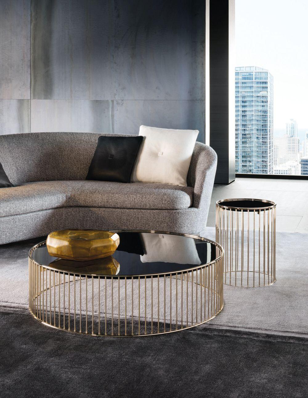nesting table, black glass top, golden legs, grey rug, grey sofa