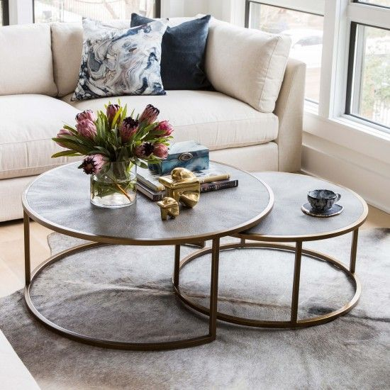 nesting table, grey top, golden lines, wooden floor, grey rug, white brown sofa