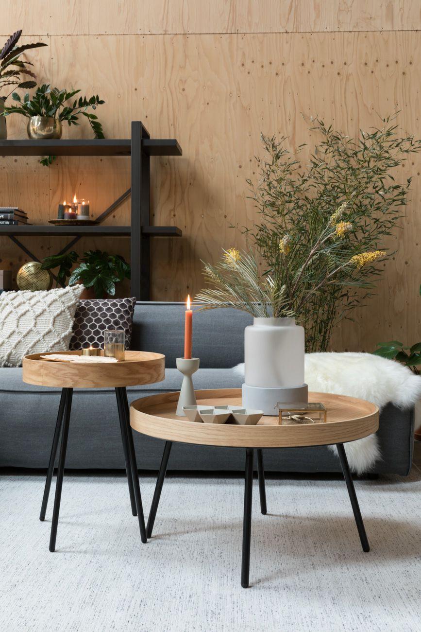 nesting table, wooden, black legs, grey rug, grey sofa
