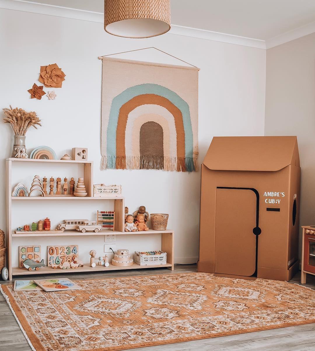 nursery, grey floor, brown patterned rug, brown tent, wooden shelves