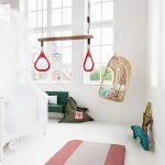 Nursery, White Wall, White Floor, Rattan Swing Chair, White Crib, Green Bench