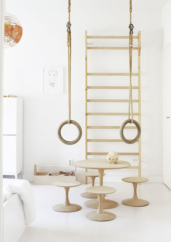nursery, white wall, white floor, wooden rack, wooden round table and chairs