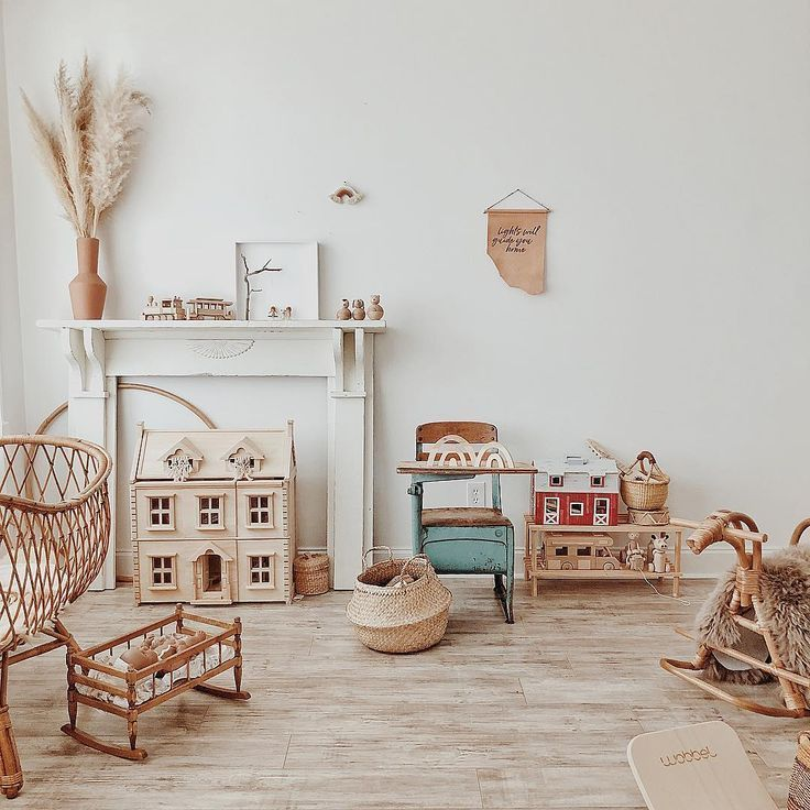 nursery, wooden floor, white wall, wooden toys, rattan crib