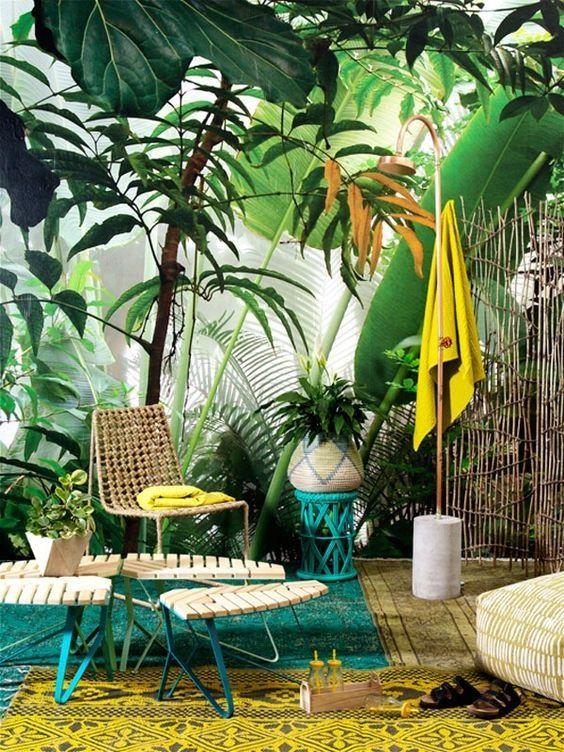 patio, green  rug, yellow rug, plants, green white bench