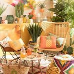Patio, Patterned Rug, Rattan Chair, Leather Chair, Wooden Coffee Table, Yellow Wall
