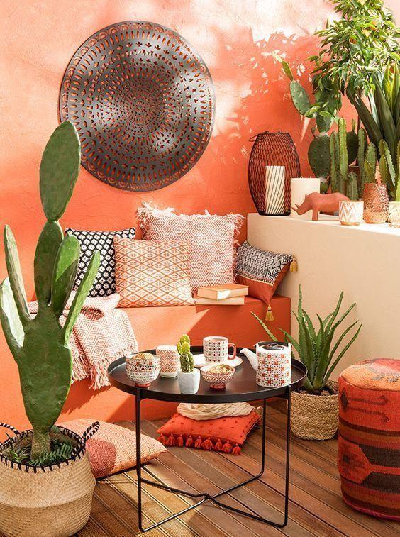 patio, wooden floor, orange wall, white wall, rattan pots, black tray coffee table