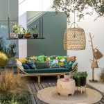 Patio, Wooden Floor, White Wall, Green Wall, Rattan Bench With Green Cushion, Rattan Round Rug, Wooden Side Table, Rattan Pendant, Plants, Floating Shelves