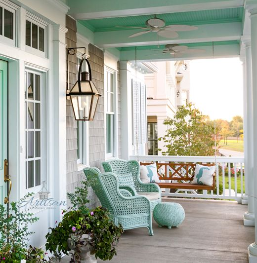 patio, wooden floor, wooden wall, turquoise rattan chairs, sconces, turquoise rattan ottoman, turquoise wooden ceiling