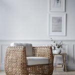 Rattan Chair With White Cushion, Grey Wooden Floor, White Wall, White Wainscoting