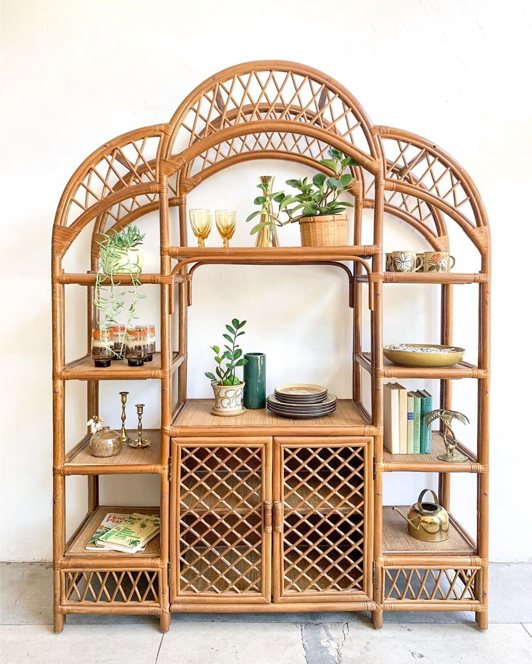 rattan shelves with curve on top, boards in the middle, cupboard below