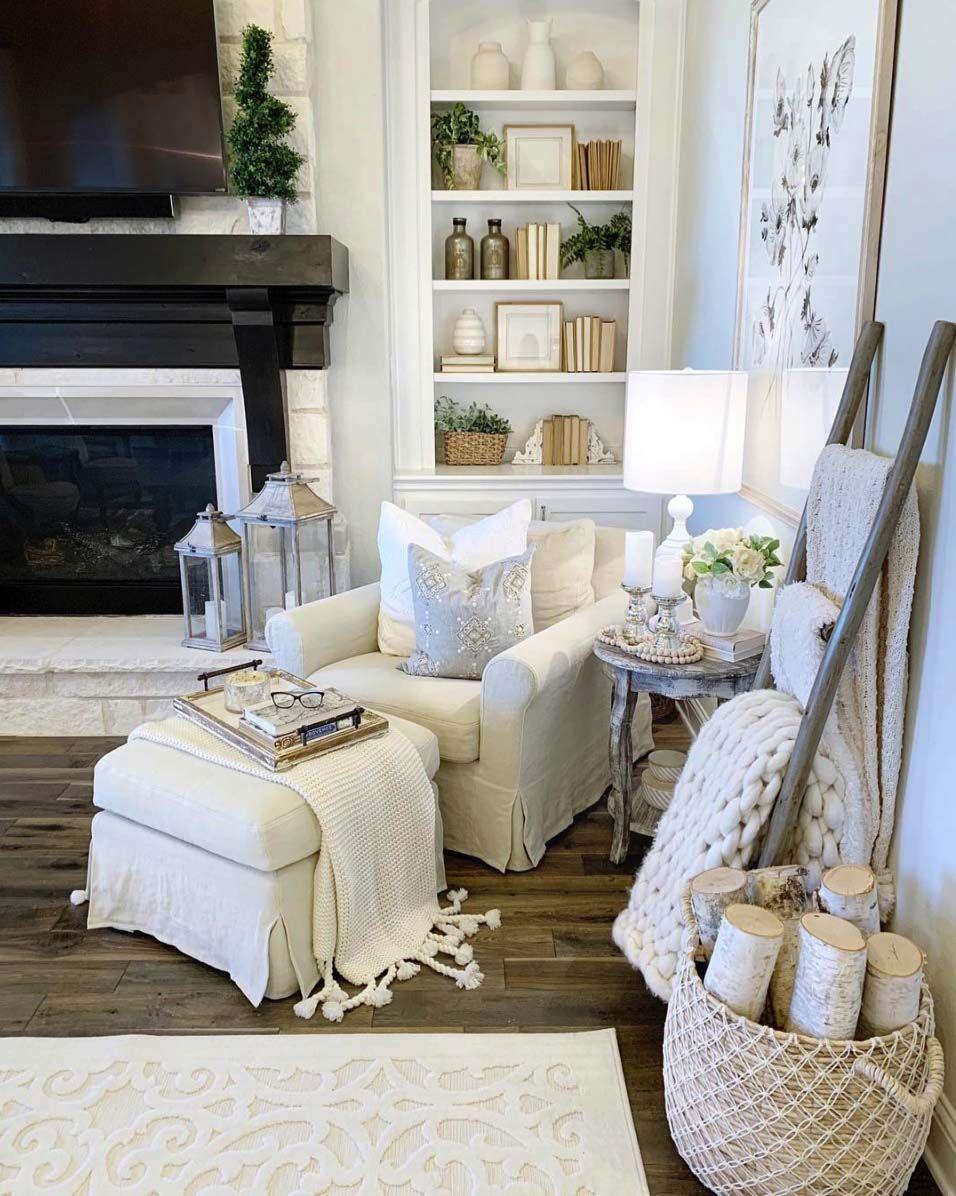 reading spot, wooden floor, white wall, white shelves, white chair, white ottoman, white wooden side table, black white fireplace