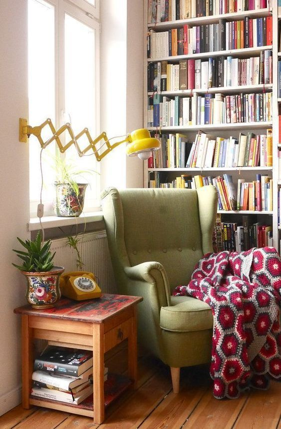 reading spot, wooden floor, white wall, wooden side table, white wooden shelves, yellow sconce