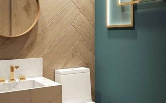 small toilet, green wall, wooden herringbone accent wall, white marble floating sink, white toilet, round toilet