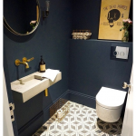 Small Toilet, Patterned Floor, Dark Blue Wall, White Floating Toilet, Floating Sink, Round Mirror
