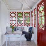Sunroom, Grey Floor, White Wall, White Wooden Ceiling, Red Framed Window, Red Door, White Built In Bench, White Pillows