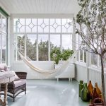 Sunroom, White Wooden Floor, White Wooden Wall, Large Window Glass, Rattan Chair, Wooden Table, White Swing
